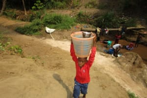 The Water Project: Benke Community, Brima Lane -  Carrying Water