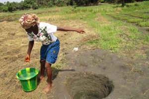 The Water Project: Mayaya Village A -  Fetching Water