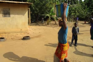 The Water Project: Kafunka Community -  Carrying Water
