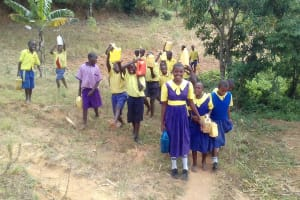 The Water Project: Emukhalari Primary School -  Carrying Water Back To School