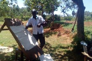 The Water Project: Bumavi Community, Shoso Mwoga Spring -  Staff Wilson Kipchoge Conducting Training