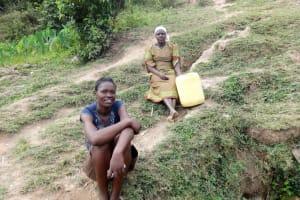 The Water Project: Shitungu Community B, Charles Amala Spring -  Women Wait Their Turn