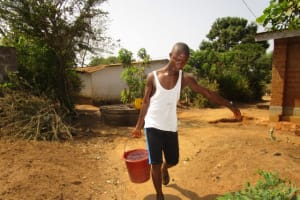 The Water Project: New London Community, Magburaka Road -  Carrying Water