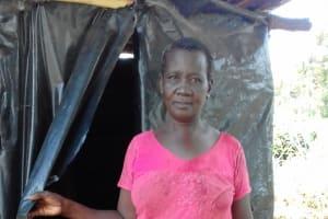 The Water Project: Igogwa Community -  Mrs Jane Proud Of Her Improvised Latrine