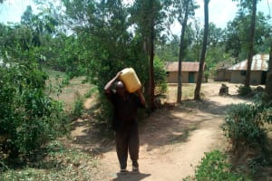The Water Project: Handidi Community, Kadasia Spring -  Old Man Struggles With Water
