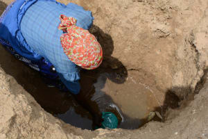The Water Project: Ilinge Community A -  Family One Fetching Water