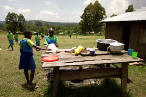 The Water Project: Musunji Primary School -  Students Washing Utensils