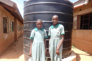 The Water Project: Emukangu Primary School, Butere -  Girls Next To The Liter Tank
