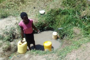 The Water Project: Handidi Community, Malezi Spring -  Lifting A Full Container