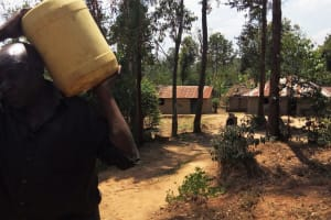 The Water Project: Handidi Community, Kadasia Spring -  Carrying Water