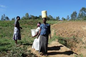 The Water Project: Shiamboko Community, Oluchinji Spring -  Carrying Water On Head