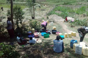 The Water Project: Handidi Community, Malezi Spring -  Washing Clothes
