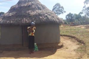 The Water Project: Futsi Fuvili Community, Futsi Fuvili Spring -  Mrs Nellie In Front Of Her Home