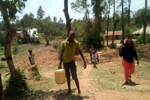 The Water Project: Handidi Community, Kadasia Spring -  Boy Posing With Water Container