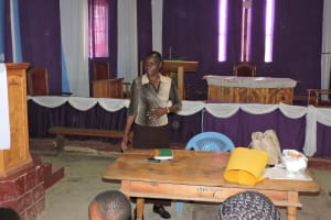The Water Project: Compassion Primary School -  Staff Mary Afandi Conducting Training