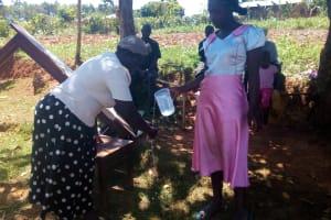 The Water Project: Bumavi Community, Shoso Mwoga Spring -  Hand Washing Demonstrations