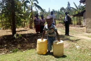 The Water Project: Handidi Community, Malezi Spring -  Brian Showing Off His Muscles