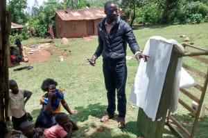 The Water Project: Shikhuyu Community -  Field Officer Erick Wagaka Facilitating Training