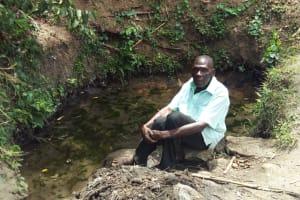 The Water Project: Shikhambi Community, Daniel Inganga Spring -  Mr Inganga At Inganga Spring
