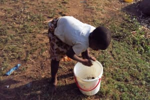 The Water Project: Shitoto Community, William Manga Spring -  Cleaning Out A Container