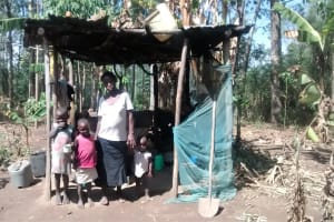 The Water Project: Isese Community, Sylvanus Spring -  Alice And Her Children In The Kitchen