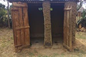 The Water Project: Futsi Fuvili Community, Shikanga Spring -  Latrines