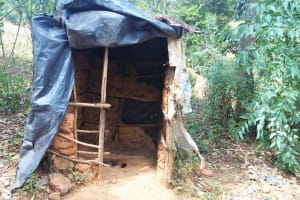 The Water Project: Shitoto Community, William Manga Spring -  Traditional Latrine