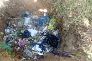 The Water Project: Isese Community, Sylvanus Spring -  Garbage Pit