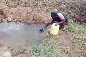 The Water Project: Simuli Community, Lihala Sifoto Spring -  Mrs Lihala Fetching Water