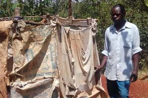 The Water Project: Shikhambi Community, Daniel Inganga Spring -  Mr George And His Latrine