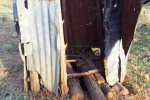 The Water Project: Mumuli Community, Shalolwa Spring -  Latrine Floor