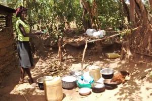 The Water Project: Mungulu Community, Zikhungu Spring -  Washing Utensils