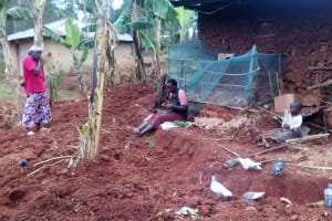 The Water Project: Simuli Community, Lihala Sifoto Spring -  Mrs Lihala Relaxes In Her Backyard