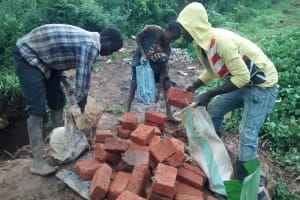 The Water Project: Shikhuyu Community -  Community Members Gather Materials