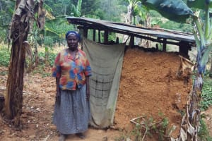 The Water Project: Shitoto Community, William Manga Spring -  Rodah By Her Latrine