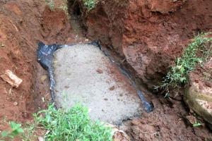 The Water Project: Mutambi Community, Kivumbi Spring -  Excavating And Setting Foundation Base