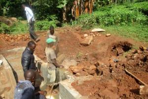 The Water Project: Mutambi Community, Kivumbi Spring -  Backfilling Process