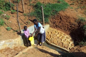 The Water Project: Shitaho Community B, Isaac Spring -  Mother And Son Fetch Water