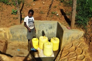 The Water Project: Shitaho Community B, Isaac Spring -  Girl Waiting To Fill Containers