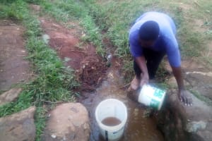 The Water Project: Lutonyi Community, Shihachi Spring -  Fetching Water From Shihachi Spring