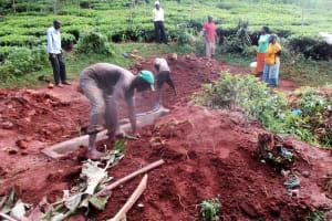 The Water Project: Mutambi Community, Kivumbi Spring -  Planting