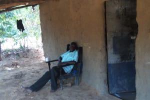 The Water Project: Shikhambi Community, Daniel Inganga Spring -  Mr Inganga Relaxes Outside His House