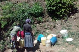 The Water Project: Handidi Community, Matunda Spring -  Scramble Around The Water Point