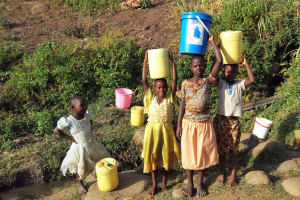 The Water Project: Shitoto Community, William Manga Spring -  Girls Fetch Water From Manga Spring