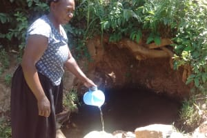 The Water Project: Irenji Community, Shianda Spring -  Fetching Water