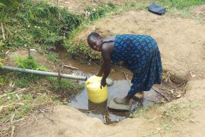 The Water Project: Futsi Fuvili Community, Shikanga Spring -  Fetching Water