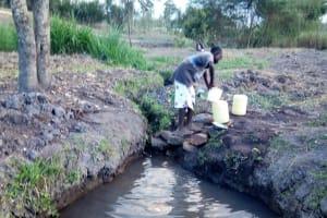 The Water Project: Mwiyala Community, Benard Spring -  Fetching Water