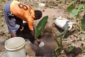The Water Project: Mungulu Community, Zikhungu Spring -  Fetching Water