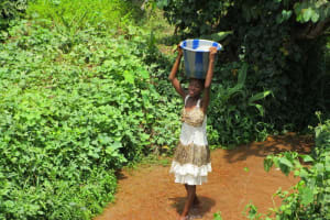 The Water Project: Kasongha Community, 16 Komrabai Road -  Carrying Water