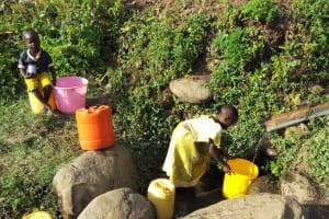 The Water Project: Shitoto Community, William Manga Spring -  Fetching Water